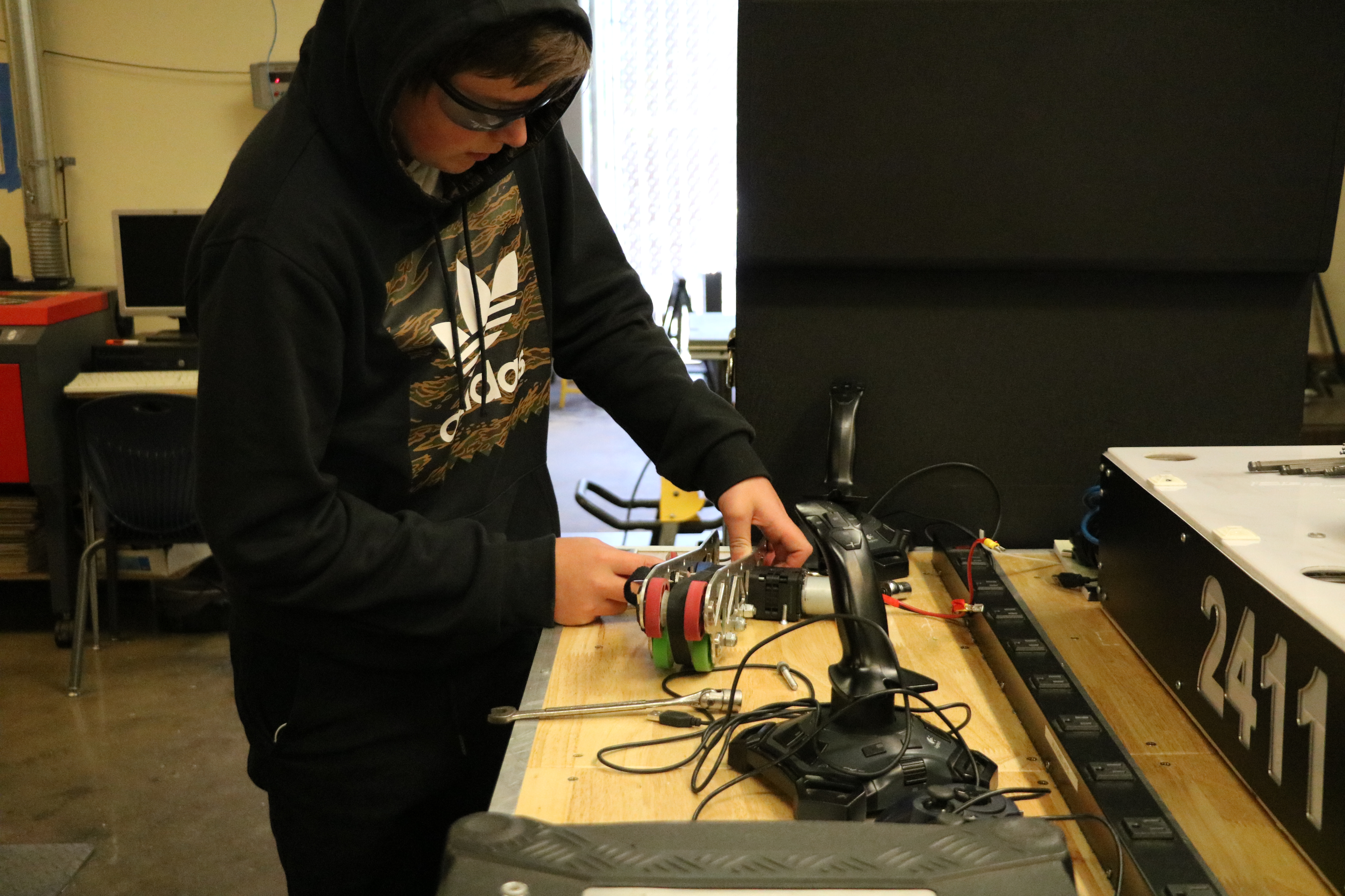 James Ericson Working on disassembling a part of the robot.